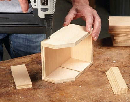<b>Photo 4: Assemble the bins</b></br> <p>Join the parts with glue and brads. The glue will provide plenty of strength, so drive only as many brads as needed to hold the parts together while the glue sets.</p>