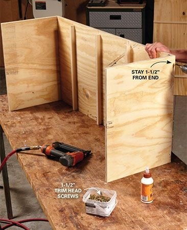 <b>Photo 2: Assemble the carcass</b></br> <p>Fasten the sides to the top and bottom with glue and brads, and then add screws. To avoid splitting the plywood, drill pilot holes for the screws and stay 1-1/2 in. from the ends.</p>