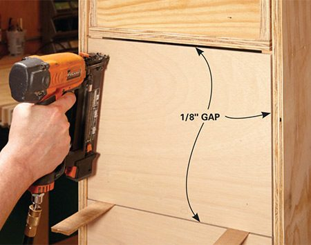 <b>Photo 6: Position the drawer fronts</b></br> <p>Slip the drawer boxes into the cabinet. Center the drawer fronts and shim under them to achieve 1/8-in. gaps. Secure the fronts to the drawer boxes with glue and one brad in each corner.</p>