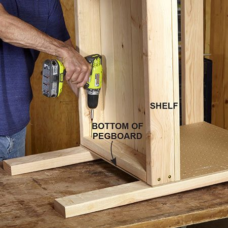 <b>Photo 5: Add the shelf</b></br> <p>Rest the bench on one end. Slide the shelf between the legs and line it up with the bottom of the pegboard. Screw through the shelf into the legs.</p>