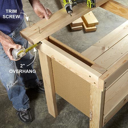 <b>Photo 6: Mount the top boards</b></br> <p>Starting at the back, align the first 2x6 flush to the back and measure for the 2-in. overhang on the side. Attach the 2x6 with trim screws. Attach the rest of the boards the same way. The front 2x6 will overhang the frame about 2 in.</p>
