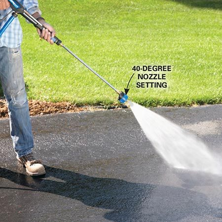 <b><b>Photo 2:</b> Rinse with a strong stream</b></br> Flush the soap and dirt residue with a 40-degree power washer nozzle or a strong stream of water from your garden hose.