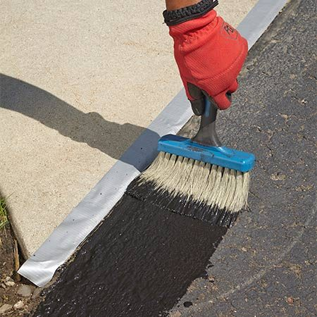 <b><b>Photo 5:</b> Cut in the edges</b></br> Dip the dashing brush into the sealer and apply a liberal coating to all four edges of the driveway. Don't spread it too thin; you want it to fill in all the pores.