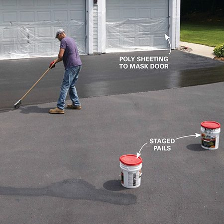 <b><b>Photo 6:</b> Stage the pails</b></br> Guesstimate the coverage of each pail and stage each additional pail along the driveway. That saves time and reduces the need to walk through wet sealer to get the next pail.