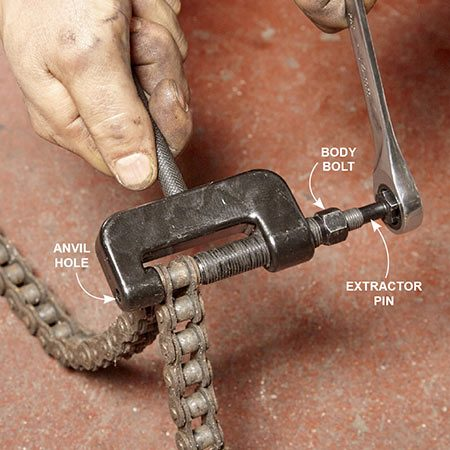 <b>Photo 5: Break the chain</b></br> Select an extractor pin to match the pin size of your chain and screw it into the body bolt. Secure the breaking tool directly over a chain pin and tighten the body bolt. Force the chain pin out of the link and through the anvil hole by tightening the extractor pin.