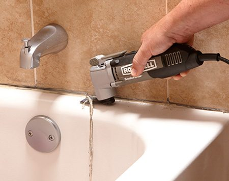 <b>Photo 1: Cut and peel the old caulk</b></br> <p>Slice through the caulk along the walls with a utility knife or with an oscillating tool equipped with a flexible scraper blade. Then use your knife or tool to scrape along the tub or shower floor.</p>