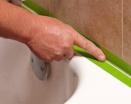 <b>Photo 5: Tool with your finger</b></br> <p>Wet your finger with water and start at an outer corner. Wipe your finger across the caulk to create a rounded bead and remove excess caulk from the gap.</p>