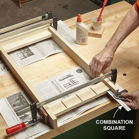 <b>Photo 6: Glue table sides</b></br> <p>Glue the sides of the table. Use a combination square to make sure the stretcher is in the correct position.</p>