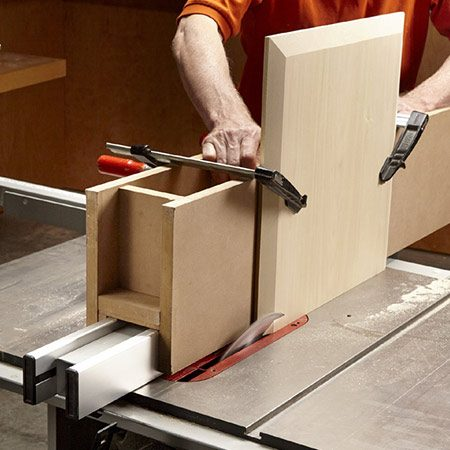 <b>Photo 10: Saw bevel edges</b></br> <p>Saw bevels around the table's top. Use a tall sliding fence to support the top.</p>