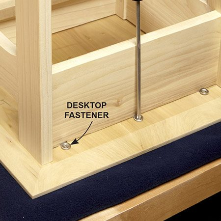 <b>Photo 11: Fasten top to base</b></br> <p>Screw the top to the base using desktop fasteners. Positioned on the outside, they won't interfere with the drawer.</p>