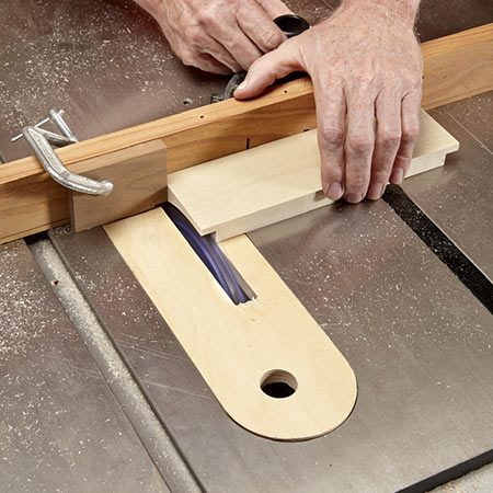 <b>Photo 12: Cut rabbets</b></br> <p>Begin making the drawer by using a dado set to cut rabbets in the drawer's front.</p>