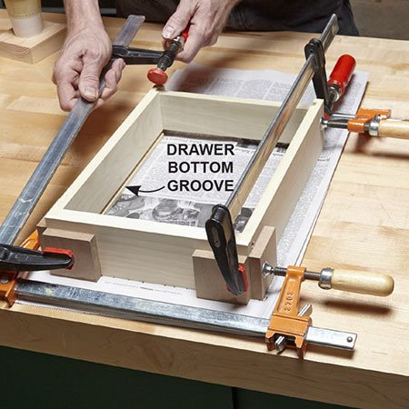 <b>Photo 14: Glue the drawer</b></br> <p>Glue the drawer together. Position the back of the drawer so it sits just above the groove for the drawer's bottom.</p>