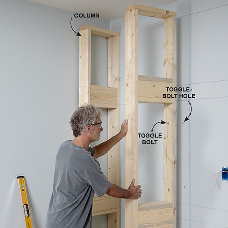 <b>Photo 5: Set the columns</b></br> <p>Screw the outside columns to the base. Plumb them and attach them to the wall with screws or drywall anchors. Position the center columns, plumb them and attach them the same way.</p>