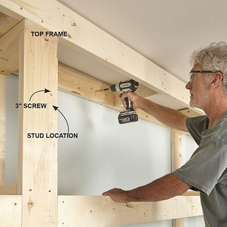 <b>Photo 6: Mount the top frame</b></br> <p>Slide the top into place over the columns. Line up the columns so the shelves fit and screw them to the top frame. Then screw the top frame to the wall.</p>