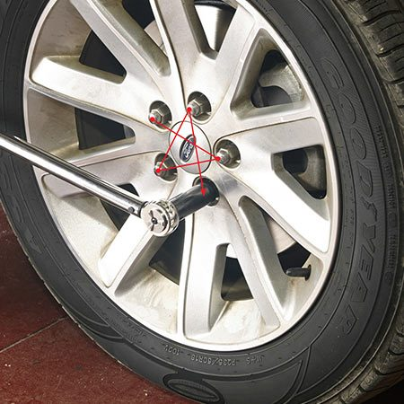 <b>Photo 11: Torque the lug nuts</b></br> <p>Remove the jack stand and lower the vehicle until the tire just touches the ground. Set the torque wrench to one-half the specified torque and tighten the lug nuts in a star pattern. Then set the wrench to the full torque and tighten again in the same star pattern. Lower the vehicle the rest of the way and remove the floor jack.</p>