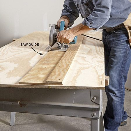 <b>Photo 1: Rip the plywood top to width</b></br> <p>Use a homemade saw guide and a circular saw, or a table saw, to cut the plywood for the 16-in.-wide top shelf.</p>