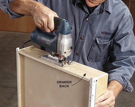 <b>Photo 1: Cut away the top half of the drawer back</b></br> <p>Use a jigsaw to cut away a little more than half of the drawer back.</p>