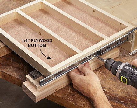 <b>Photo 4: Install the tray</b></br> <p>Attach the plywood bottom to the tray with nails or brads. Screw the tray to the drawer slides so the top of the tray is flush with the top of the drawer. Then reinstall the drawer.</p>