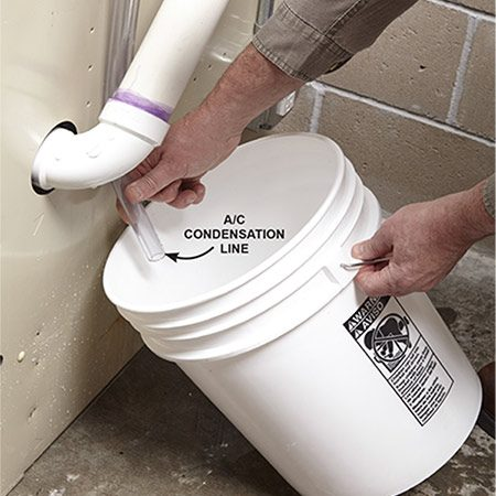 <b><b>Photo 3:</b> Catch the water while you wait for parts</b></br> Remove the pump and aim the drain tubes into a bucket. Empty often to prevent overflowing. Then reinstall the pump with the new check valve when it arrives.