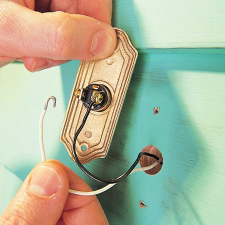 <b>Photo 2b: Replace the button</b></br> Connect the wires to the new button just as they were connected to the old one. Screw the button to the wall and you're done.