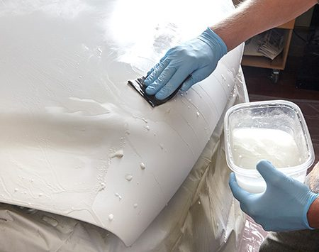 <b><b>Photo 5:</b> Sand the primer</b></br> Starting with wet 600-grit sandpaper, smooth the primer and feather the edges. Then switch to wet 1,000-grit sandpaper to final-sand the entire repair, including the blended areas.