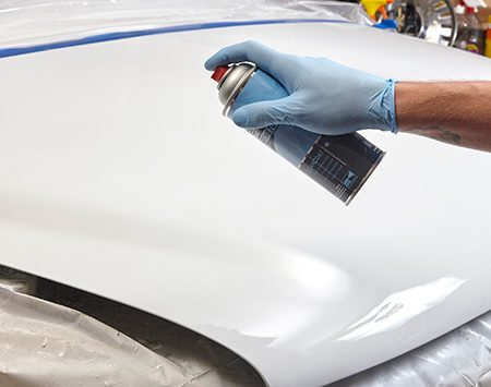 <b><b>Photo 7:</b> Spray on the clear coat</b></br> Apply several coats of clear coat, allowing the recommended drying time between coats. Gradually work the clear coat into the surrounding painted areas to achieve a smooth blend line.