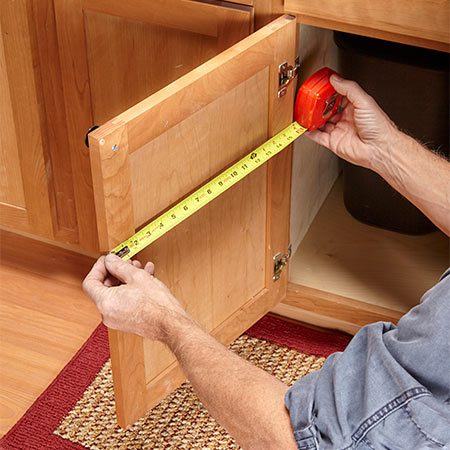 <b>Photo 1: Measure to size the rack</b></br> Measure the width of the door and cut the rack shelves 4-1/2 in. shorter than that measurement. Measure the height of the cabinet opening and cut the rack sides 1 in. shorter.
