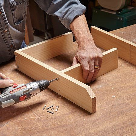 <b>Photo 2: Build the rack</b></br> Mark the location of the top shelf on the sides. Drill screw holes and fasten the sides to the shelves using 2-in. screws and finish washers. Add the slats, apply a finish and screw brackets to the rack.
