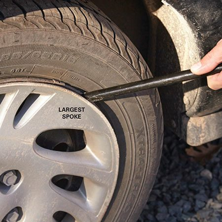 <b>Screw-on or snap-on?</b></br> <p>Carmakers use two methods to secure plastic wheel covers: spring clips and screw-on plastic lug nuts. If you don't know which type is on your vehicle, try turning one of the plastic nuts with the socket end of your tire iron. If it rotates, you have the screw-on type. Unscrew all the plastic nuts and lift off the cover.</p>  <p>If the nut doesn't turn, you have the snap-on style. Those have to be pried off, and that's where some people get into trouble. If you jam the tapered end of your tire iron into a weak area on the cover, you'll break it to pieces. So be sure to pry behind one of the larger spokes and twist until the cover pops off.</p>