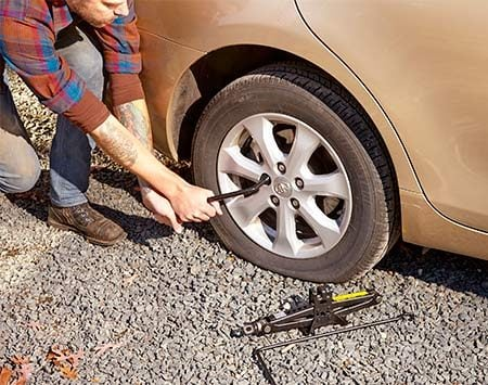 <b>Save your back</b></br> <p>There's no way you can loosen the lug nuts once you raise the vehicle—the tire will just spin. Instead, break loose—but don't remove—the lug nuts while the tire is still on the ground. To save your back, place the tire iron on each lug nut so the handle is in the 9 o'clock position. Place both hands on the tire iron and push down with all your might. If that doesn't work, use a downward bouncing motion with your weight to break the nut loose.</p>