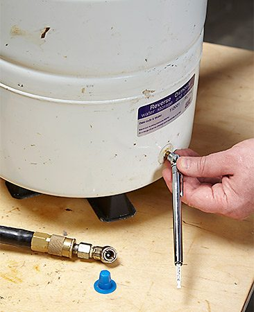 <b>Check the tank's empty pressure</b></br> <p>Unscrew the protective cap and check the tank pressure. Inflate or deflate with a tire pump to achieve the manufacturer's recommended pressure (usually 5 to 7 psi).</p>