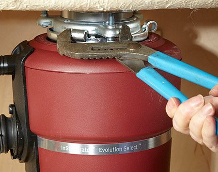 <b>Easier on the wrists</b></br> <p>When you hang the new disposal, rotating the lower mounting ring tightens the seal between the disposal and the sink flange. The lower ring rides up a set of ramps on the upper ring—pretty neat! But the final inch or so of rotation requires a fair amount of force.</p>  <p>The easiest way to apply that force is to squeeze them together using tongue-and-groove pliers, such as Channellocks. You'll need medium or large pliers to do this. Unlike prying on the lower ring with a screwdriver or hex wrench—the method recommended in most instruction sheets—squeezing can't disturb the position of the sink flange and cause it to leak. Plus, it's easier on the wrists.</p>