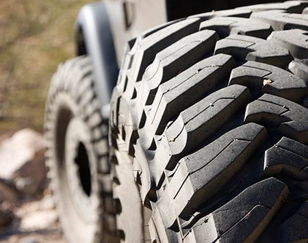 """<b>Not all trucks are for off-roading</b></br> <p>The """"off-road"""" look is the hottest trend in truck tires these days. They look tough, with beefy, aggressive and exaggerated tread blocks. But despite their cool appearance, they most likely will have poor """"road manners,"""" meaning they provide a stiff ride, poor comfort and equally poor handling. And they're very noisy at highway speeds.</p>  <p>The next hottest trend is retrofitting trucks and SUVs with extra-large wheels and low-profile tires (less sidewall distance between the wheel and the tread). Like off-road tires, this combination provides a very harsh ride. Plus, the larger wheels decrease braking ability, slow acceleration, cause faster suspension wear and can decrease overall stability. And, since there's less rubber between the tread and the wheel, the wheels experience more damage when they hit potholes.</p>"""