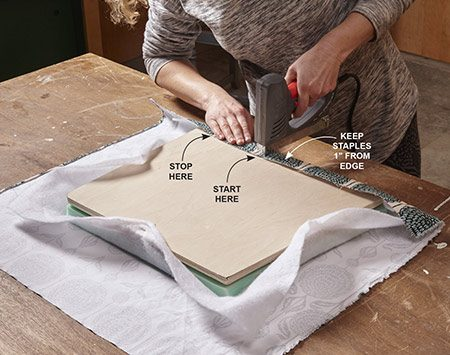 <b>Photo 6: Staple the front edge</b></br> Working from the center outward, install staples along the front as you lightly tension the material with your hand. Stop 2 in. from the corner. Flip the seat over several times to check the pattern as you go. Repeat the process along the back edge and sides.