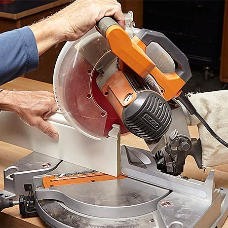 <b>Photo 1: Make a miter cut</b></br> The 45-degree cut will—through the magic of geometry—provide a perfect profile to guide your coping cut. When you make the miter cut, leave the baseboard a couple inches too long. You can cut it to final length after the coping is done.