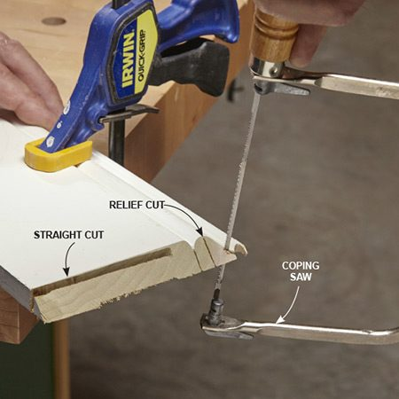 <b>Photo 2: Cut the cope</b></br> Follow the profile created by the miter cut. Relief cuts at tight turns allow waste to fall away and your saw to make turns more easily. You can make straight cuts faster and better with a miter saw (more on that later).