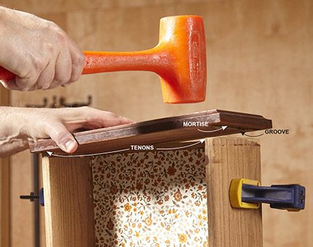 <b>Photo 1: Reinstall the drawer front</b></br> Remove the drawer pull and screws. Then line up the mortise-and-tenons and the drawer bottom with the groove and tap the drawer front back onto the box.
