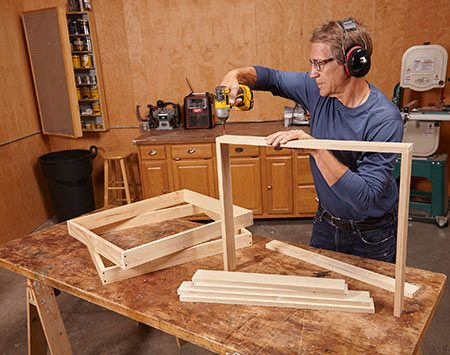 <b>Photo 1: Build four frames</b></br> One will form the top of the cabinet and another will form the bottom. The two wing frames must be sized to suit the height of your miter saw's table.
