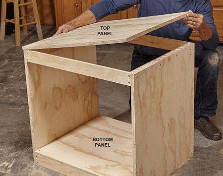 <b>Photo 4: Add the top and bottom panels</b></br> Carefully align the panels with the edges of the frames to ensure that the cabinet is square.