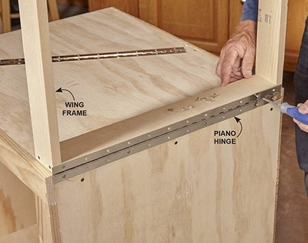 <b>Photo 6: Secure the wings</b></br> Install the hinges with the wing positioned as shown to give you the right hinge height.