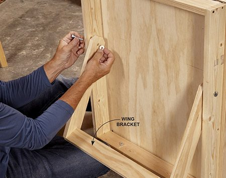 <b>Photo 7: Mount the brackets</b></br> Cut the wing brackets and position the holes as shown in Figure A.