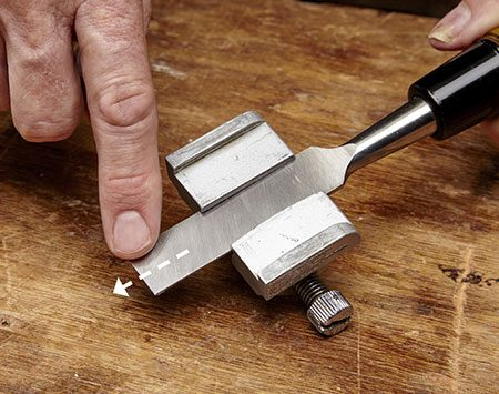 "<b>Photo 5: Feel for a ""wire edge""</b></br> Keep honing until you can feel a slight ridge of metal start to form all the way across the chisel's back. This ""wire edge"" indicates that the chisel's end is sharp."