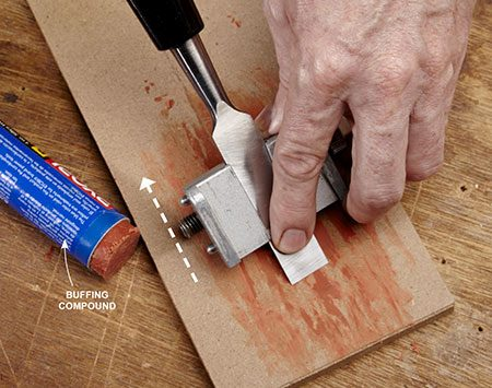 <b>Photo 7: Polish the edge</b></br> Set the chisel back 1/16 in. in the guide, then drag the edge backward on a piece of wood charged with buffing compound. The result: wicked sharp!