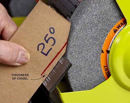 <b>Photo 11: Set the grinding angle</b></br> Reset the grinder's tool rest to 25 degrees. A cardboard guide is accurate enough.