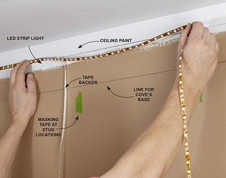 <b>Photo 1: Stick on the Strip Lights First</b></br> <p>If you plan to attach the lights to the wall, it's easier to install the lights before you build the cove.</p>