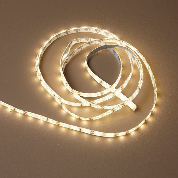 <p><b>Plug-in LED strip lighting:</b> Home centers sell strip lighting with a prewired transformer. These would work well for shorter runs but need to be plugged into a receptacle hidden behind the cove. They can be wired to a regular switch, but the dimmer is located on the transformer, which won't be easily accessible. $8 per ft. for 8 ft.</p>