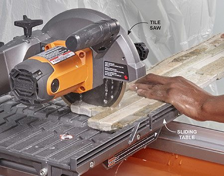 <b>Photo 7: Cut ends with a tile saw</b></br> <p>Mark the stone and set it on the sliding table of your tile saw. Line up the mark with the blade. Turn on the saw and simply slide the table toward the blade to cut through the stone.</p>