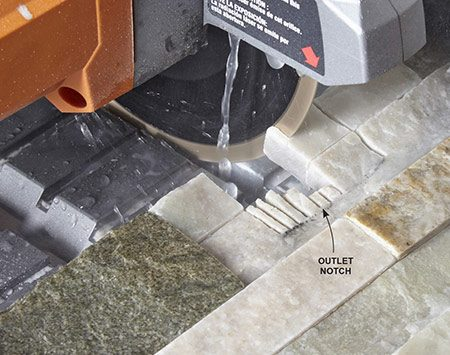 <b>Photo 12: Notch around outlets</b></br> <p>Cut out the notch with the tile saw by making a series of closely spaced cuts that end at the line for the bottom of the notch. Tilt the stone up to create a square-bottom cut. Then break out the fingers and clean up the cut with a back-and-forth motion through the saw.</p>