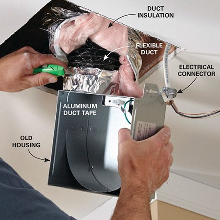 <b>Photo 3: Disconnect and remove old parts</b></br> Unscrew the old fan housing from the joist. Then disconnect the electrical cable from the housing. Finally, slice through the duct sealing tape with a utility knife and disconnect the duct.