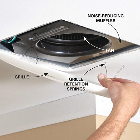 <b>Photo 7: Install the fan and grille</b></br> Slide the fan assembly into the housing until it snaps in place. Secure with screws. Plug the electrical connector into the electrical box mounted earlier. Then screw in the noise-reducing muffler. Squeeze the grille springs and snap the grille into place.